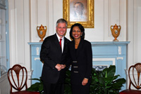 Robert C. OBrien, Partner, Arent Fox LLP and Secretary Rice. State Dept. photo