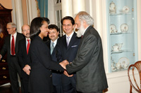 Secretary of State Rice, (shaking hands with) Abdul Jabar Sabit , Afghanistan's Attorney General, and Said T. Jawad, Ambassador Extraordinary and Plenipotentiary of Afghanistan (looking on). State Dept. photo
