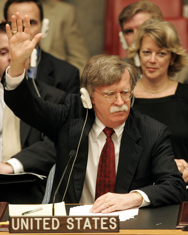 Ambassador John Bolton raises his hand to vote during a meeting of the UN Security Council