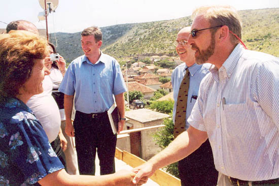 Ambassador Clifford G. Bond (far right) meets refugees who have returned to their home in Stolac, Bosnia and Herzegovina.