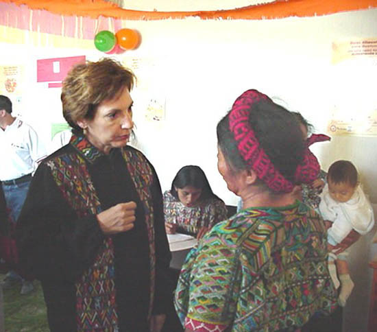 Ambassador Prudence Bushnell talks with a mother in San Juan Cotzal, Quiche department (province) about the assistance local children receive from a nutrition center operated by the Q'esalenam Community Development Organizations Association.