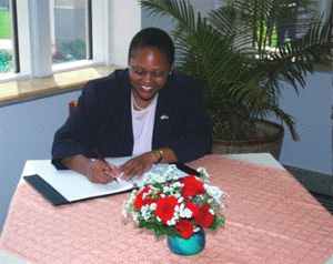 Assistant Secretary Fraser signs book (State Department Photo).