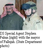 DS Special Agent Stephen Fakan [right] with the mayor of Fallujah. [State Department photo]
