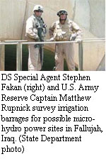 DS Special Agent Stephen Fakan [right] and U.S. Army Reserve Captain Matthew Rupnick survey irrigation barrages for possible micro-hydro power sites in Fallujah, Iraq. [State Department photo]