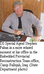 DS Special Agent Stephen Fakan in a more relaxed moment at his office in the Embedded Provincial Reconstruction Team office, Camp Fallujah, Iraq. [State Department photo]