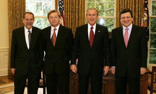 EU leaders pose for photo standing next to President Bush left to right are Javier Solana, Jean-Claude Juncker, President Bush, and Jose Manuel Barroso