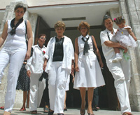 Cuban jailed dissidents� families walk out of the Santa Rita Church, Sunday May 11, 2003 in Havana. For the third Sunday, prisoners� wives wearing white clothes protest the conditions their husbands a
