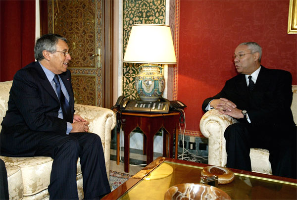 U.S. Secretary of State Colin Powell, right, talks with Moroccos Foreign Affairs Minister Mohamed Ben Aissa, left, during their their meeting at the Foreign Ministry, in Rabat, Morocco. [AP Photo]