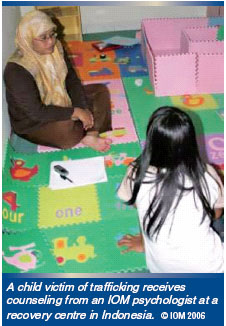 A child victim of trafficking receives counseling from an IOM psychologist at a recovery center in Indonesia. IOM Photo