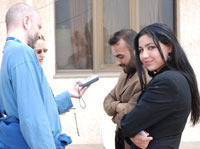 Iraqi broadcasters from the Independent Radio and Television Network of Diyala are interviewed by members of the international media at an event marking the official launching of the new independent network in Iraq on March 25, 2007.
