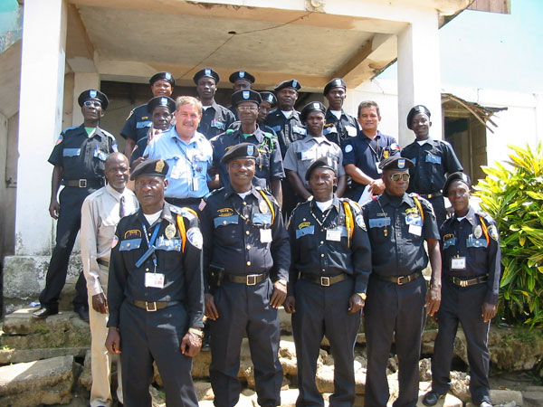 U.S. police advisors donate new uniforms to Liberian National Police. State Dept. photo