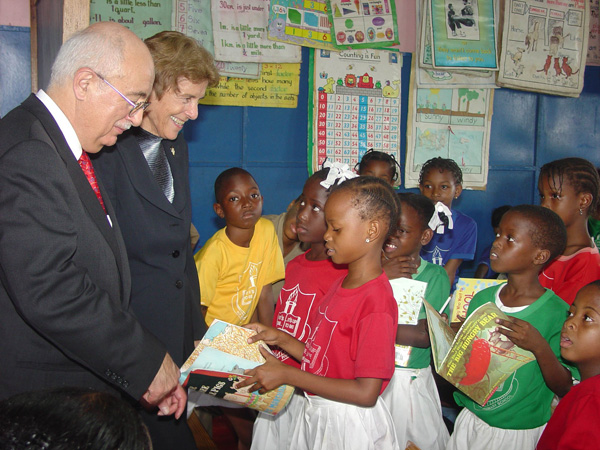 Ambassador to the Organization of American States John Maisto and Ambassador to Jamaica Sue Cobb greet children at a Jamaican school.