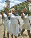 Cuban jailed dissidents� families demonstrate outside of St. Rita�s Church in Havana. AP photo