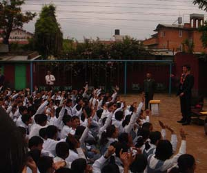 Presidential Management Fellow Paul Neville takes questions on American culture at Lalitpur Secondary Boarding School in Nepal. [State Dept. Photo]