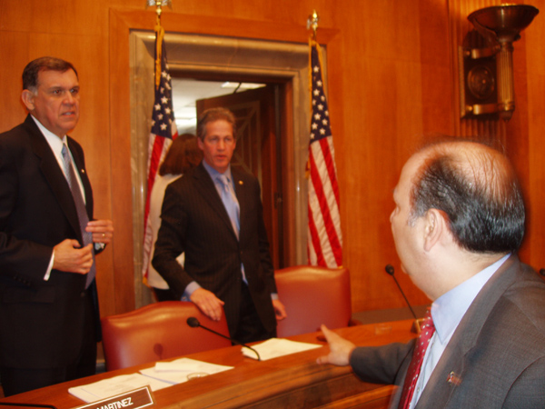 Assistant Secretary Noriega, right, greets Senators Martinez, left, and Coleman after a Senate Foreign Relations Committee hearing on the State Departments 2005 Western Hemisphere priorities.
