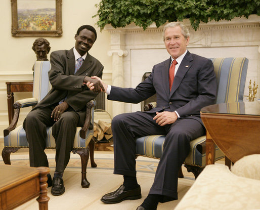 President George W. Bush welcomes Sudanese Liberation Movement leader Minni Minnawi to the Oval Office Tuesday, July 25, 2006 [White House Photo].