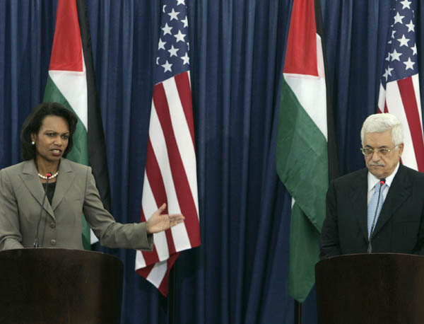 Secretary Rice gestures toward Palestinian President Mahmoud Abbas during a joint press conference. c AP photo
