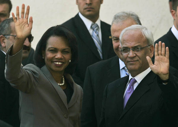 Secretary Rice and Palestinian Chief Negotiator Saeb Erekat wave to crowd. c AP Photo