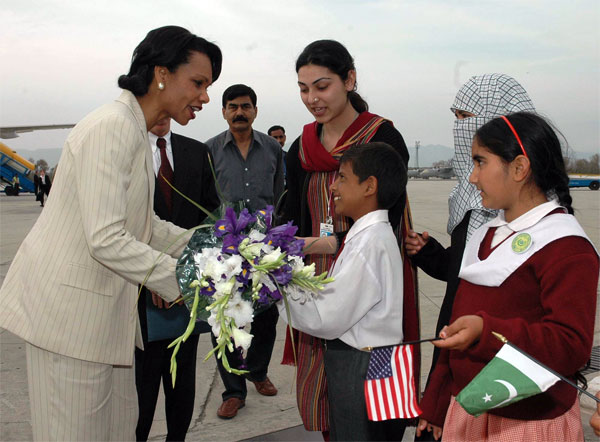 Secretary Rice receives flowers from Pakistani children upon her arrival in Islamabad, Pakistan on Wednesday, March 16, 2005. [State Department Photo]