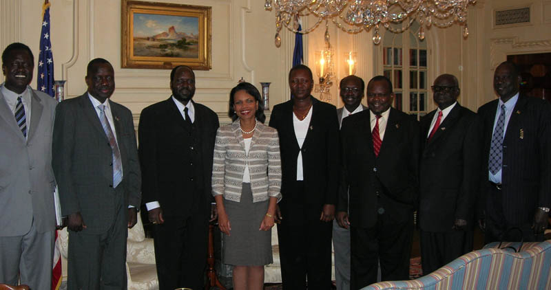 Secretary Rice stands with the Sudanese delegation [State Department Photo 7/2006].