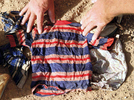 A child's garment found in a shallow grave. CPA photo.