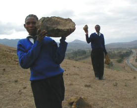Students collecting stones for foundation of 36-bed girls' hostel being constructed in Tanzania