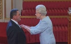 Date: 05/16/2008 Description: Mines Advisory Group Executive Director Lou McGrath receives the Order of the British Empire from Her Majesty, Queen Elizabeth II. © Buckingham Palace Press Office