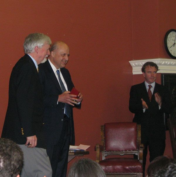 Date: 11/17/2008 Location: Dublin, Ireland Description: Deputy Secretary Negroponte is presented with a medal by Provost John Hegarty on left and moderator Tom Clonan on right at Trinity College in Dublin, Ireland State Dept Photo