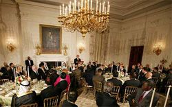 Date: 09/17/2008 Description: President George W. Bush welcomes guests to the Iftaar dinner in the State Dining Room of the White House, September 17, 2008, to celebrate the traditions of Islamic faith and culture. He honored American Muslim innovators.  [White House Photo]