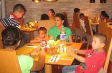 Date: 09/16/2008 Description: Orphans from the SOS Village wait for dinner to be served, September 16, 2008.   [Juliette Dickstein, U.S. Embassy Nicosia]