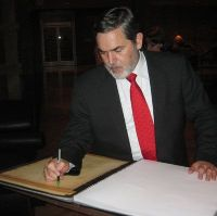 Date: 01/09/2009 Location: Mumbai, India Description: Assistant Secretary Richard Boucher signs condolence book.  State Dept Photo
